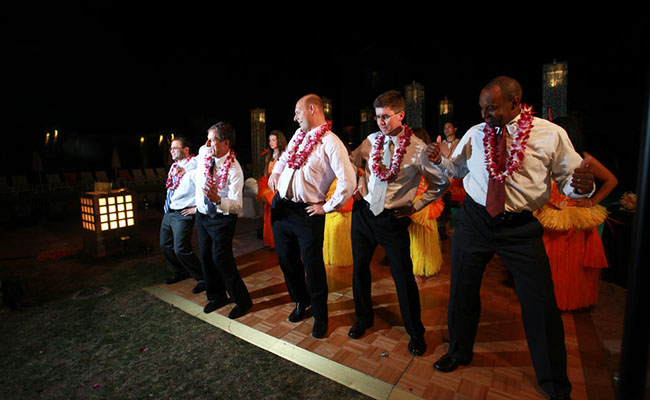 men learning a polynesian dance