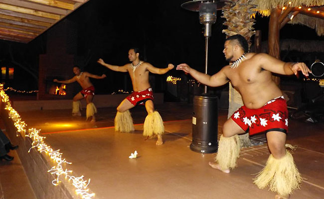 three male polynesian dancers