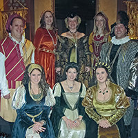 eight male and female singers attired in royal court Renaissance dress