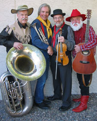 four male western attired musicians with instruments