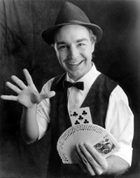 Magician with fanned deck of cards