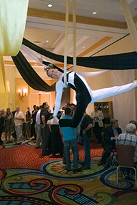 female aerialist in black white costume in silks