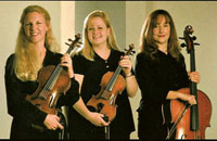 three female classical string  musicians
