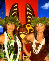 2 female costumed polynesian hula dancers