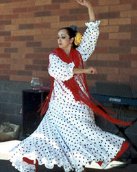 female Flamenco dancer in white dress
