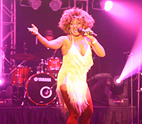 Tina Turner Impersonator in white fringe dress