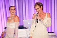 female dancer and singer in white